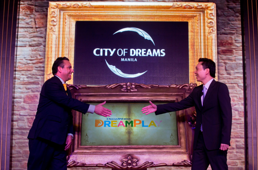 "Chairman and President of Melco Crown Philippines Mr. Clarence Chung is joined by Mr. James Clark, Head of Retail Development and Entertainment for Asia Pacific of DreamWorks Animation, in ""magically"" turning the page of an ""enchanted"" story book to officially launch the logo as part of the DreamPlay edutainment center at City of Dreams Manila announcement."